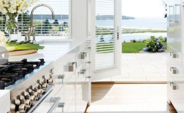 very modern white kitchen with sea view